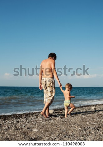 father and baby son on the beach