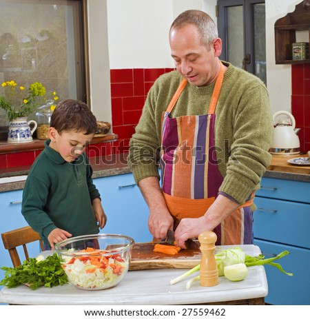 father and child cooking in the kitchen together