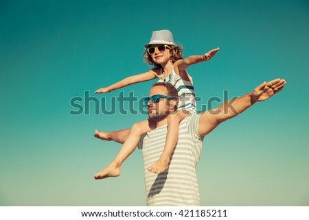 Father and child having fun on the beach. Summer vacation and travel concept #421185211
