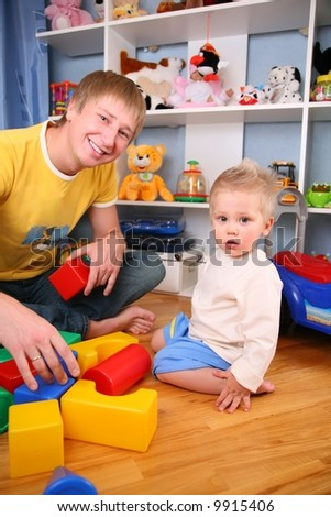 father and child in playroom 2 - stock photo