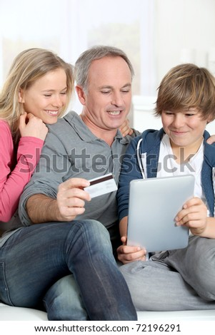 Father and children doing online shopping at home