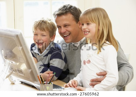 Father And Children Using Computer