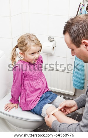 Father and Daughter Band-Aid in the bathroom