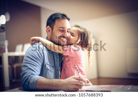 Father and daughter coloring together. - Shutterstock ID 1057688393