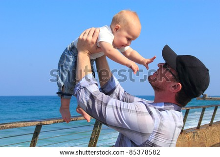 Father and daughter during a walk at sea - stock photo