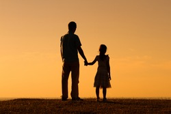 Father and daughter enjoy spending time together outdoor.Precious family moments