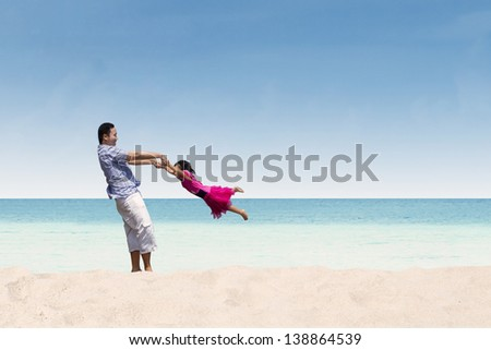 Father and daughter happy time at beach