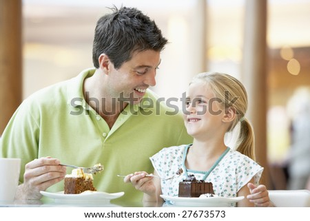 Father And Daughter Having Lunch Together At The Mall