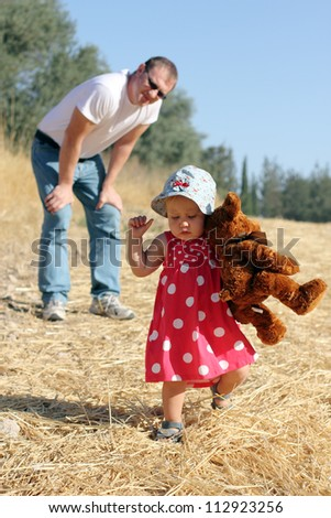 father and daughter in the autumn meadow