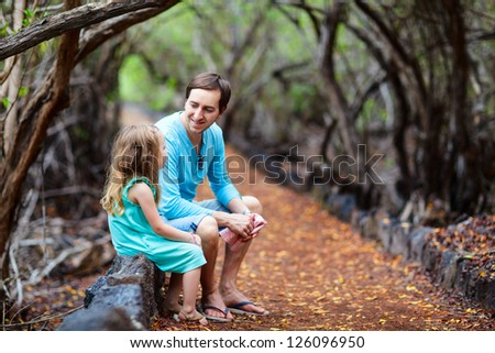 Father and daughter outdoors at beautiful forest