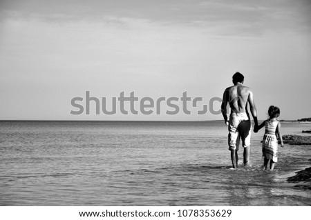 Happy girl run along the ocean coast Images and Stock Photos