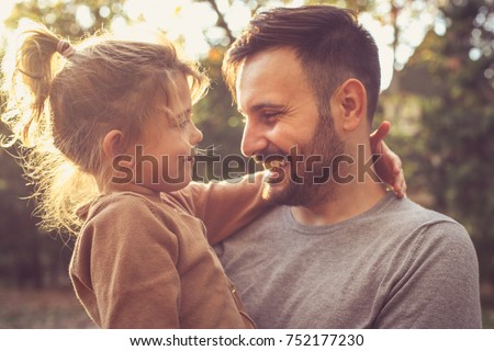 Father and daughter share love.