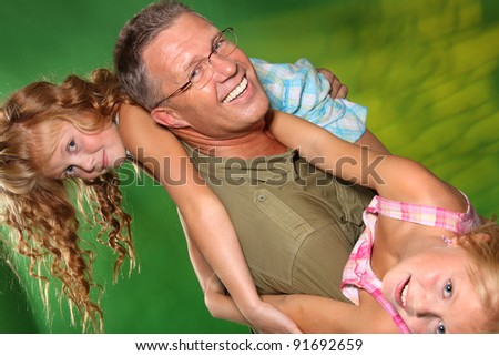 Father and daughters having fun