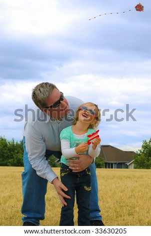 stock-photo-father-and-doughtier-flying-kite-together-at-day-time-33630205.jpg