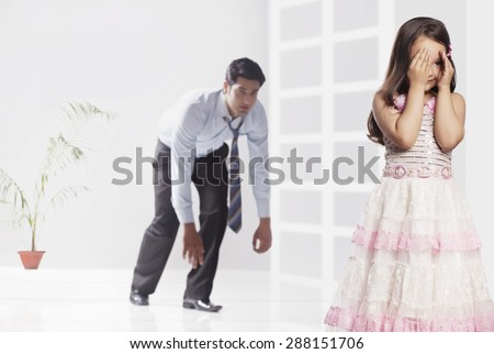 Father and girl playing hide and seek game at home #288151706