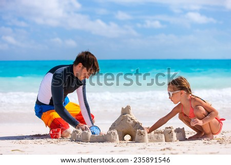 Father and his adorable little daughter at beach #235891546