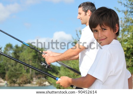 father and his little boy fishing