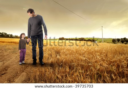 father and his little daughter  walking in the countryside