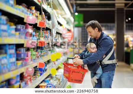 Father and his son at supermarket  ストックフォト ©