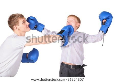 father and his son is boxing with boxing gloves. father is giving a slap to boy's face.