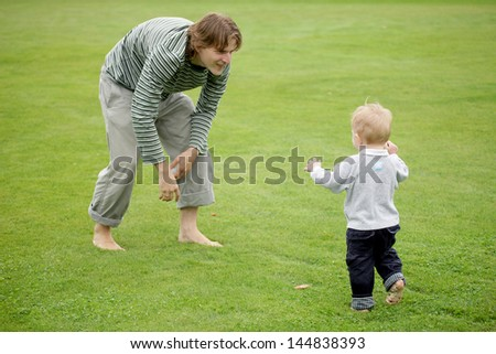 Father and his son laying in the park
