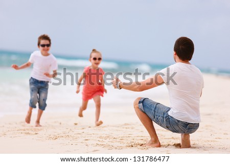 Father and kids enjoying beach vacation