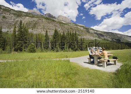 father and kids having a picnic - rocky mountains, canada