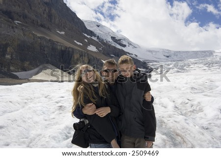 father and kids in the rockies - athabasca glacier, jasper national park, canada