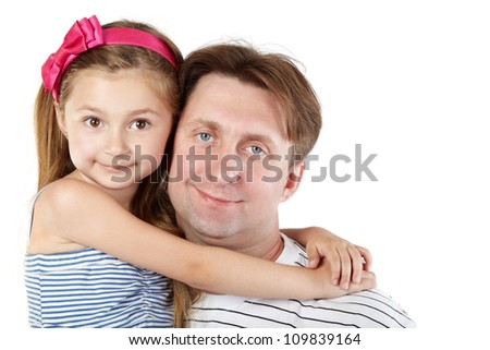 Father and little daughter cheek to cheek close-up
