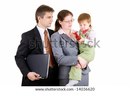 father and mother dressed for business with child