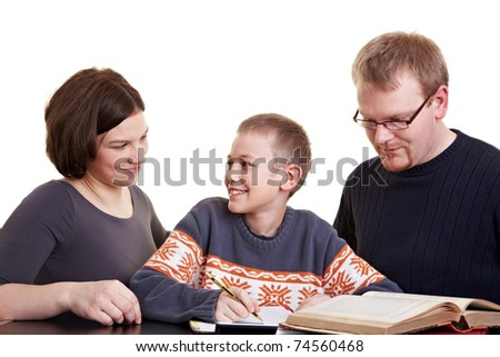 Father and mother helping son who is doing his homework