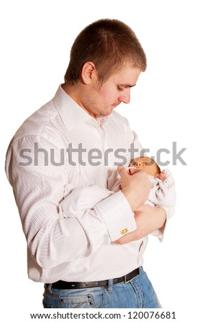 Father and newborn baby. Dad cradling baby. Baby sleeping peacefully. Isolated on white background with clipping paths.
