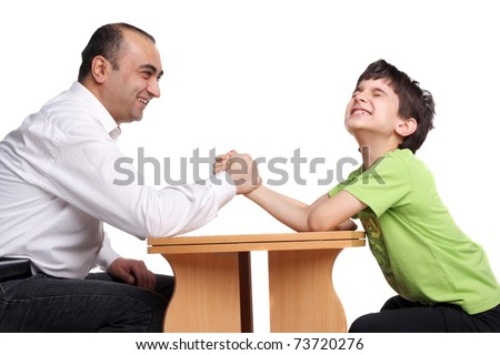 father and son arm wrestling isolated on white