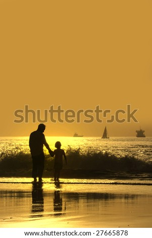 father and son at sunset in the beach