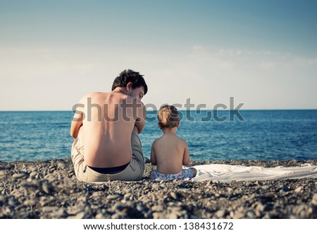 Father and son at the sea beach