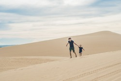 Father and son at the white desert. Traveling with children concept.