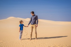 Father and son at the white desert. Traveling with children concept. Resumption of tourism after quarantine covid 19