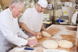 Father and son at work at their family's bakery