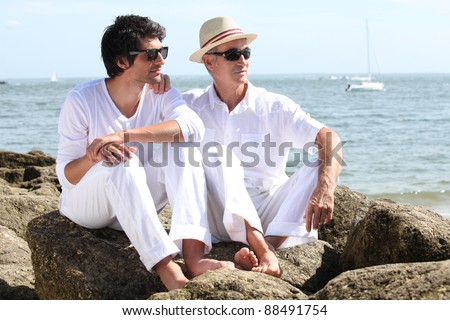 Father and son by the seaside