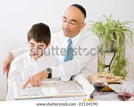father and son celebrating passover reading the Haggadah
