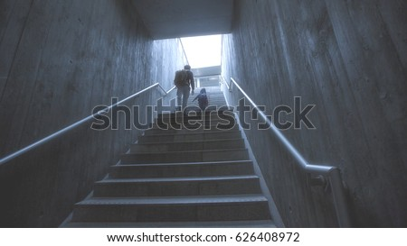 father and son climbing stairs in pedestrian subway, going to the city. Concept of family in town #626408972