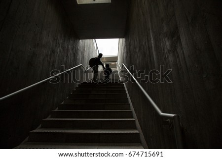 father and son climbing stairs in pedestrian subway, going to the city. Concept of family in town #674715691