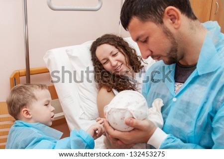 Father and son come to visit mom in the maternity ward