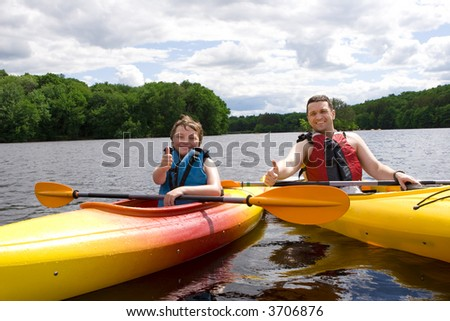 Father and son enjoying kayaking