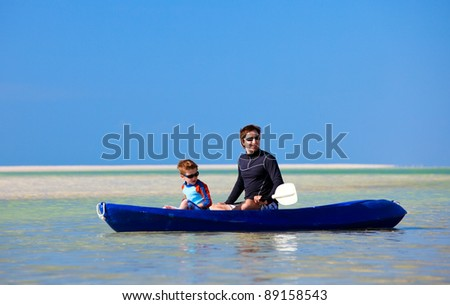 Father and son enjoying kayaking together