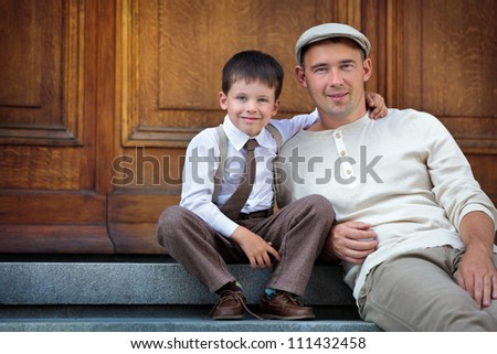 Father and son enjoying summer day in city