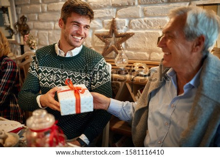 Father and son exchanging Christmas presents, Christmas presents concept
