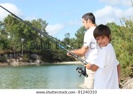 Father and son fishing together in the summertime