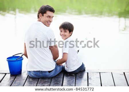 Father and son go fishing with fishing poles