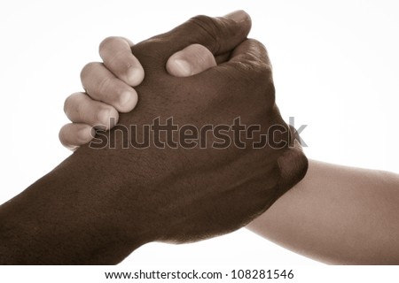 Father and son hands in arm-wrestling competition positions. Isolated over white background. Symbolizes friendship between different races and between old and young people, or learning from older.
